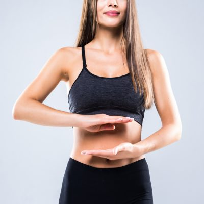beautiful-portrait-woman-hand-gesture-heart-shape-belly-girl-wearing-sport-clothing-with-exercising-isolated-white